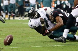 Arizona Cardinals Kerry Rhodes sacks and causes a fumble against the Philadelphia Eagles quarterback Michael Vick during the first half of their NFL football game in Phoenix